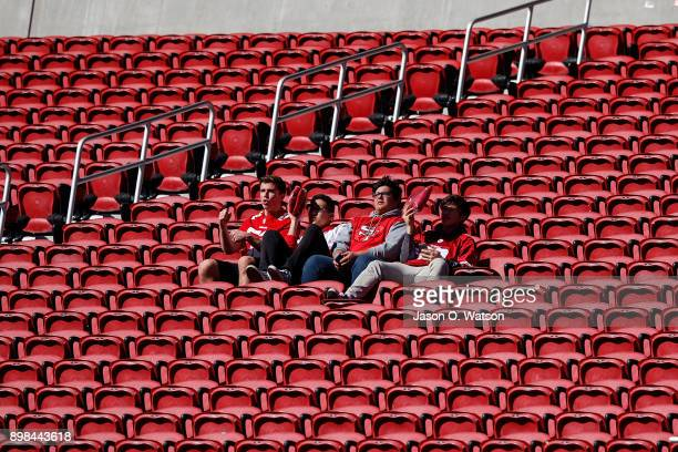 San Francisco 49ers fans sit in an empty section of seats before the game against the Tennessee Titans at Levi's Stadium on December 17 2017 in Santa...