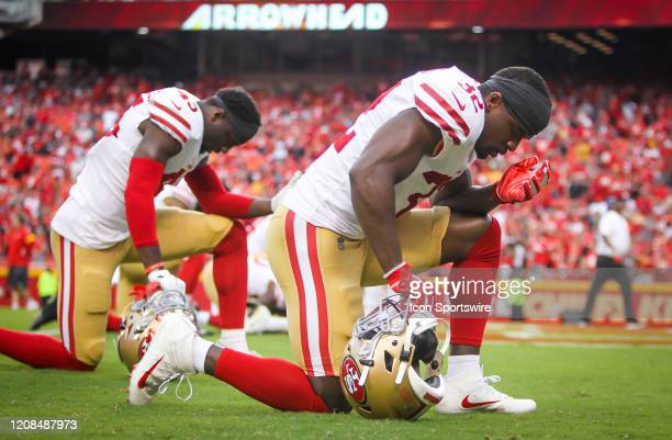 San Francisco 49ers free safety DJ Reed prays with teammates in the end zone during the preseason game between the San Francisco 49ers and the Kansas...