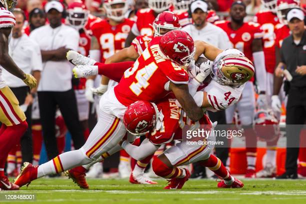 San Francisco 49ers fullback Kyle Juszczyk is upended by Kansas City Chiefs outside linebacker Damien Wilson and a teammate during the preseason game...