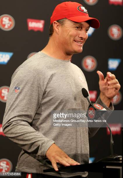 San Francisco 49ers general manager John Lynch answers questions from the news media following a joint practice with the Denver Broncos during...