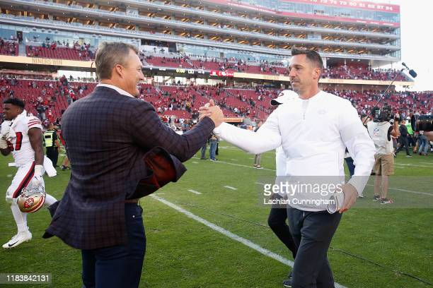 San Francisco 49ers General Manager John Lynch congratulates head coach Kyle Shanahan after a win against the Carolina Panthers at Levi's Stadium on...