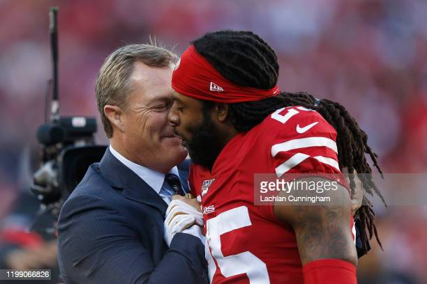 San Francisco 49ers general manager John Lynch congratulates Richard Sherman of the San Francisco 49ers during the fourth quarter of the NFC...