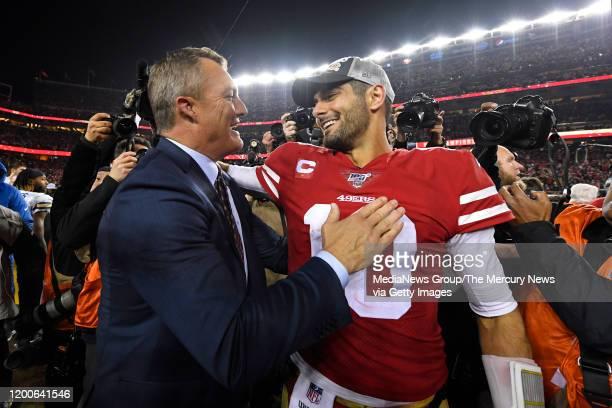 San Francisco 49ers general manager John Lynch congratulates San Francisco 49ers' quarterback Jimmy Garoppolo after winning the NFC Championship game...