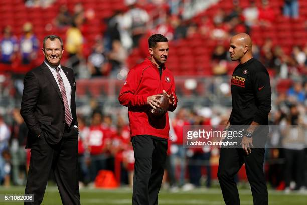 San Francisco 49ers General Manager John Lynch Head Coach Kyle Shanahan and Defensive Coordinator Robert Saleh look on during the warm up before the...