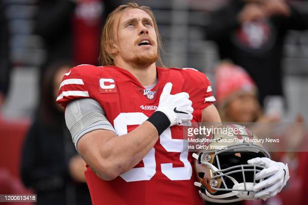 San Francisco 49ers' George Kittle prays in the end zone before the start of their NFC Championship game at Levi's Stadium in Santa Clara Calif on...