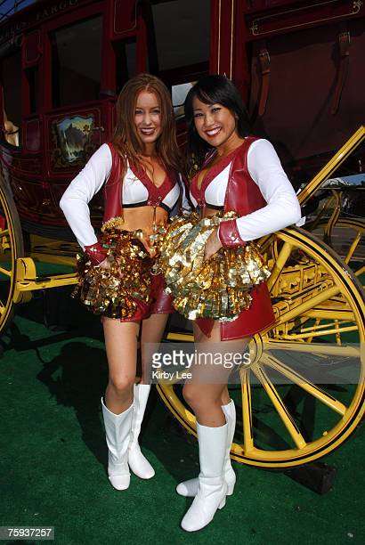 San Francisco 49ers Gold Rush cheerleaders pose at Faithful City in the Monster Park parking lot before game against the Oakland Raiders in San...