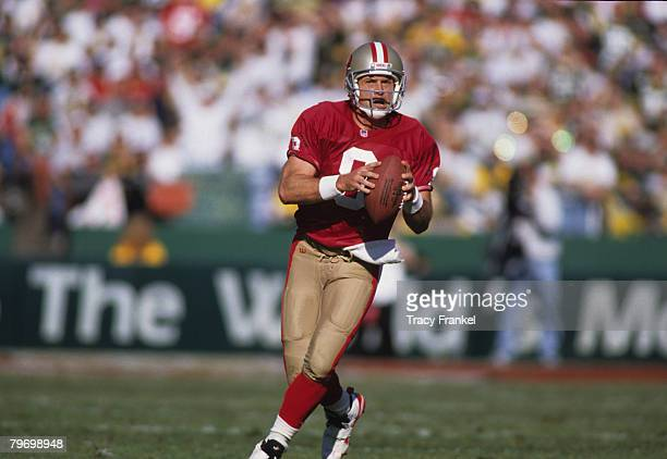 San Francisco 49ers Hall of Fame quarterback Steve Young looks downfield during the NFC Divisional Playoff a 2717 loss to the Green Bay Packers on...