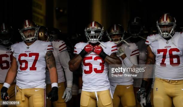 San Francisco 49ers including Daniel Kilgore of the San Francisco 49ers, NaVorro Bowman of the San Francisco 49ers and Garry Gilliam of the San...