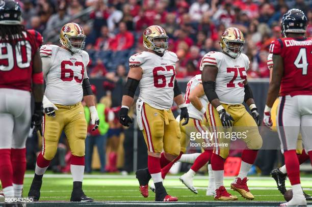 San Francisco 49ers offensive guard Brandon Fusco center Daniel Kilgore and offensive guard Laken Tomlinson walk up to the line of scrimmage during...