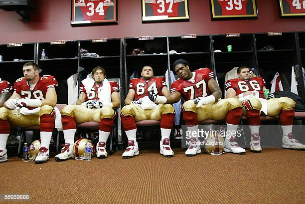 San Francisco 49ers offensive linemen Patrick Estes Adam Snyder David Baas Kwame Harris and Eric Heitmann sit in the locker room before the game...