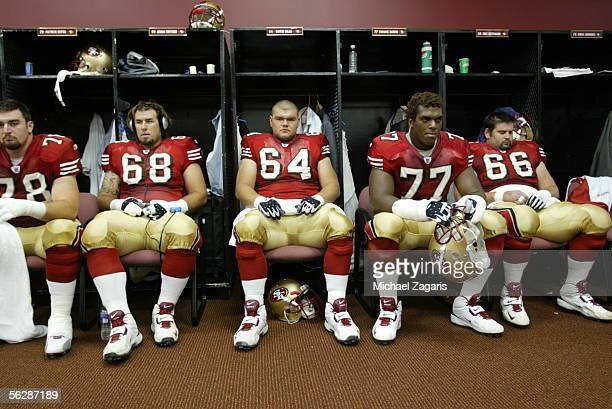 San Francisco 49ers offensive linemen Patrick Estes Adam Snyder David Baas Kwame Harris and Eric Heitmann in the locker room before the game against...
