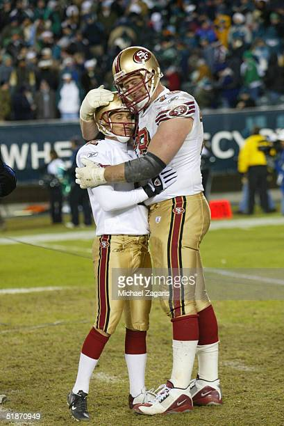 San Francisco 49ers offensive tackle Scott Gragg hugs kicker Todd Peterson after winning a field goal at Lincoln Financial Field on in Philadelphia,...