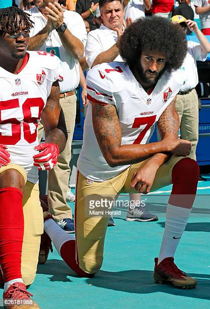 San Francisco 49ers outside linebacker Eli Harold and quarterback Colin Kaepernick take a knee during the national anthem before a game against the...