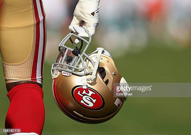 San Francisco 49ers player carries his helmet before their game against the Miami Dolphins at Candlestick Park on December 9 2012 in San Francisco...