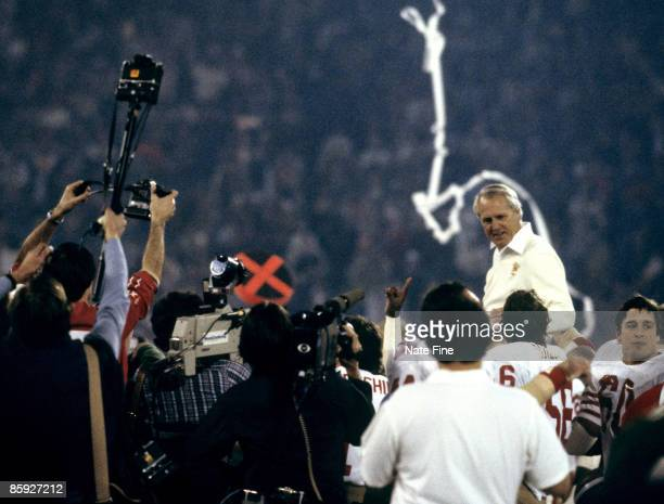San Francisco 49ers players hoist Hall of Fame head coach Bill Walsh on their shoulders following Super Bowl XVI a 2621 victory over the Cincinnati...