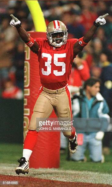 San Francisco 49ers punt returner and running back Dexter Carter celebrates after a 78 yard touchdown punt return against the Minnesota Vikings 18...