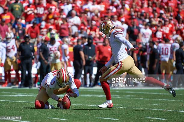 San Francisco 49ers punter Bradley Pinion holds the football for San Francisco 49ers kicker Robbie Gould for an extra point in action during an NFL...