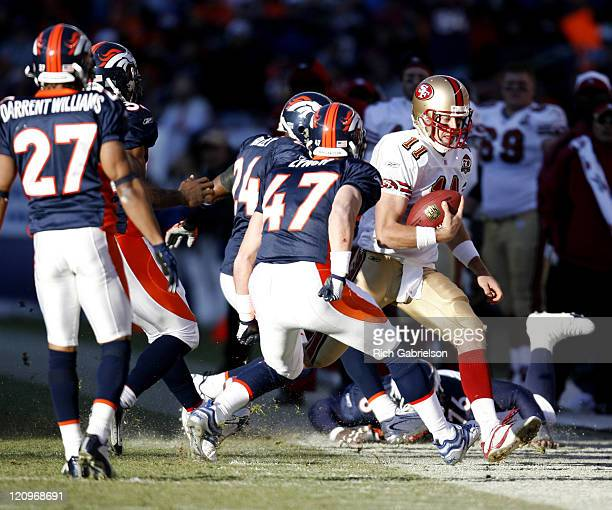 San Francisco 49ers quarterback Alex Smith is forced out of bounds by Denver Broncos safety John Lynch and cornerback Champ Bailey The San Francisco...