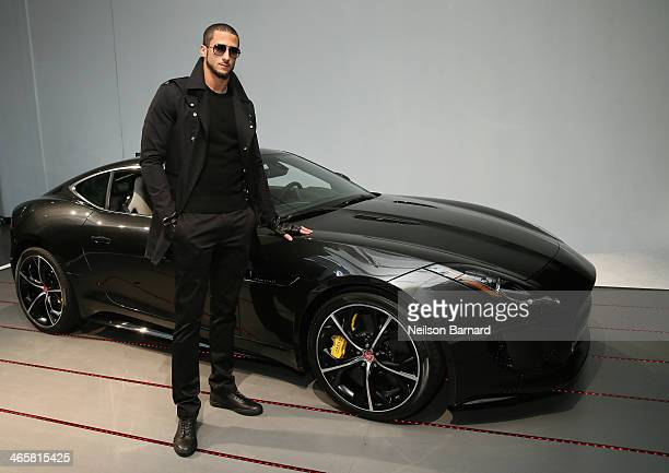 San Francisco 49ers quarterback and friend of the brand Colin Kaepernick and the allnew Jaguar FTYPE Coupe at the Jaguar and Deadspin VIP event at...