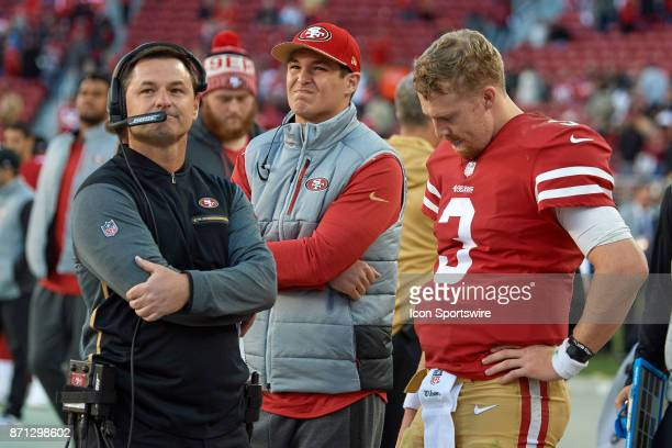 San Francisco 49ers quarterback CJ Beathard and San Francisco 49ers Quarterbacks coach Rich Scangarello react after the Arizona Cardinals intercept a...