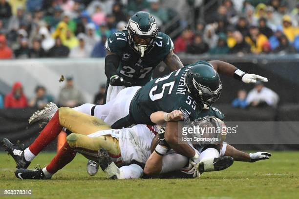 San Francisco 49ers quarterback CJ Beathard is sacked by Philadelphia Eagles outside linebacker Mychal Kendricks and Philadelphia Eagles defensive...