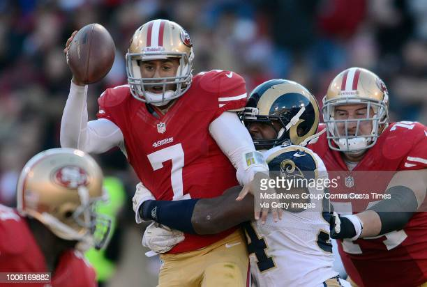 San Francisco 49ers quarterback Colin Kaepernick is sacked by St Louis Rams' Robert Quinn in the fourth quarter of their game at Candlestick Park in...