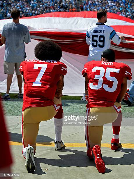 San Francisco 49ers quarterback Colin Kaepernick left and safety Eric Reid right kneel during the playing of the national anthem on Sunday Sept 18...