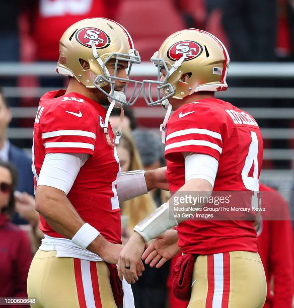 San Francisco 49ers quarterback Jimmy Garoppolo greets teammate Nick Mullins before their game against the Green Bay Packers in the NFC Championship...
