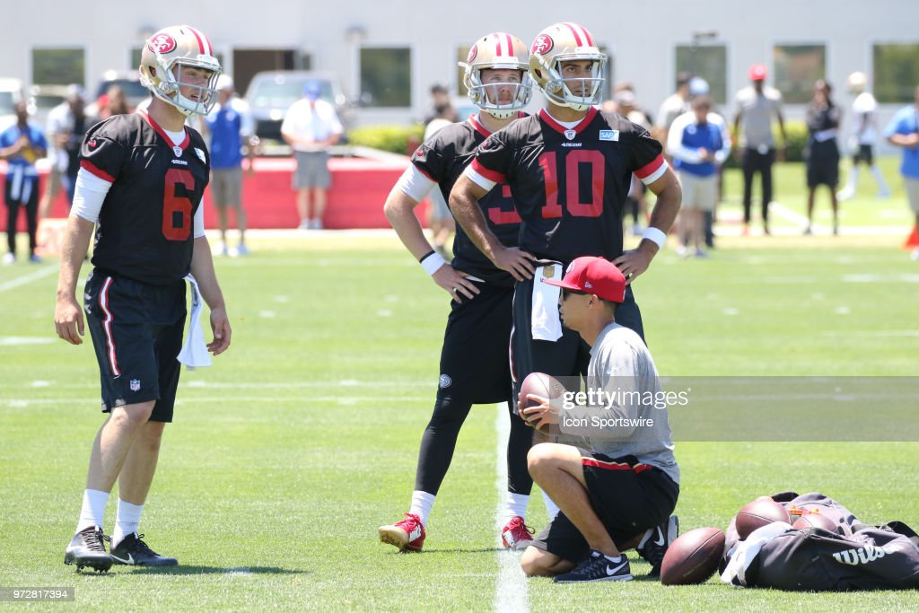 San Francisco 49ers Quarterback Jimmy Garoppolo (10), Jack Heneghan (6) and C.J. Beathard (3) watch as other teammates practice on June 12, 2018 at the SAP Performance Facility in Santa Clara, CA.