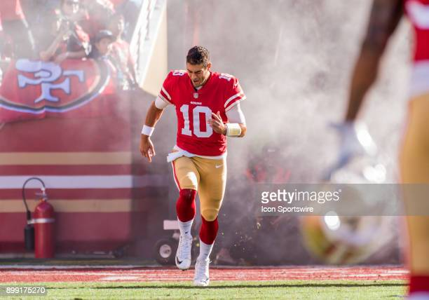 San Francisco 49ers quarterback Jimmy Garoppolo runs on the field for his debut appearance at Levi's Stadium before the game between the Tennessee...