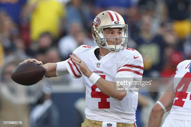 San Francisco 49ers quarterback Nick Mullens looks to pass during the first half of a game against the Los Angeles Rams at Los Angeles Memorial...