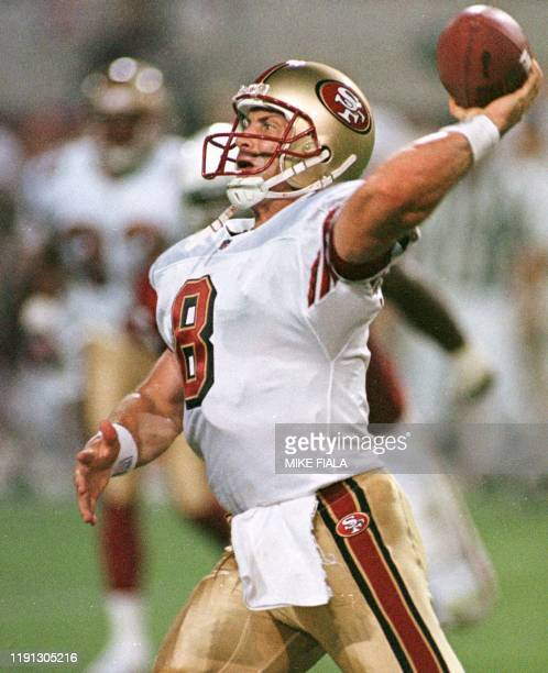 San Francisco 49ers quarterback Steve Young attempts a pass during the second quarter against the Arizona Cardinals 27 September 1999 in Tempe...
