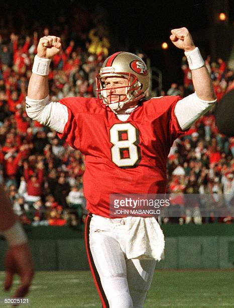 San Francisco 49ers quarterback Steve Young celebrates the touchdown run by teammate Terry Kirby in the second quarter of their NFC playoff game with...