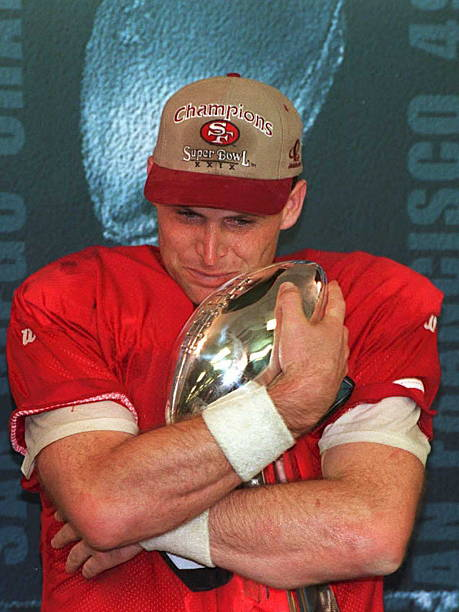 San Francisco 49ers quarterback Steve Young hugs the Vince Lombardi trophy 29 January 1995 after being named the Most Valuable Player of Super Bowl...