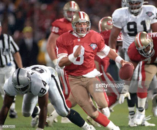 San Francisco 49ers quarterback Steve Young scrambles during 4414 victory over the Los Angeles Raiders in Monday Night Football game at Candlestick...