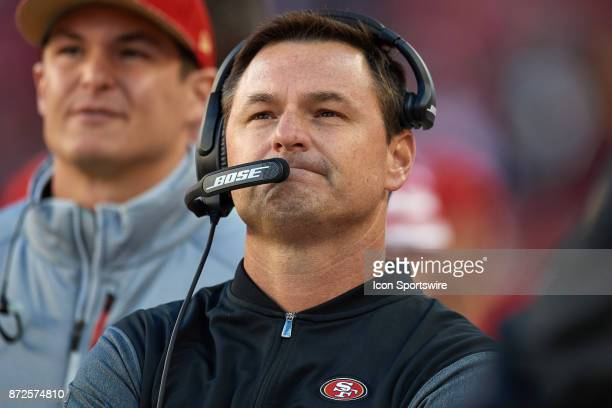 San Francisco 49ers Quarterbacks coach Rich Scangarello talks into his headset during an NFL game between the Arizona Cardinals and the San Francisco...