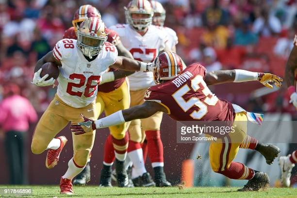 San Francisco 49ers running back Carlos Hyde battles with Washington Redskins linebacker Zach Brown during a NFL football game between the San...