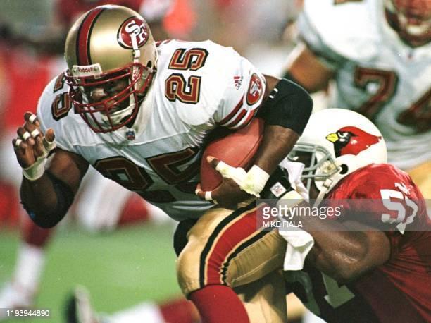 San Francisco 49ers running back Charlie Garner breaks away from Arizona Cardinals linebacker Ronald McKinnon to score the 49ers' second touchdown...