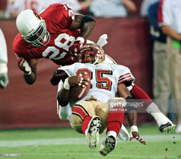 San Francisco 49ers running back Charlie Garner is tackled by Arizona Cardinals safety Tommy Bennett during the first quarter 27 September 1999 in...