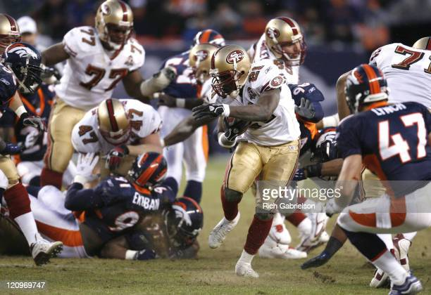 San Francisco 49ers running back Frank Gore breaks through a hole in the Denver Broncos line The San Francisco 49ers defeated the Denver Broncos by a...