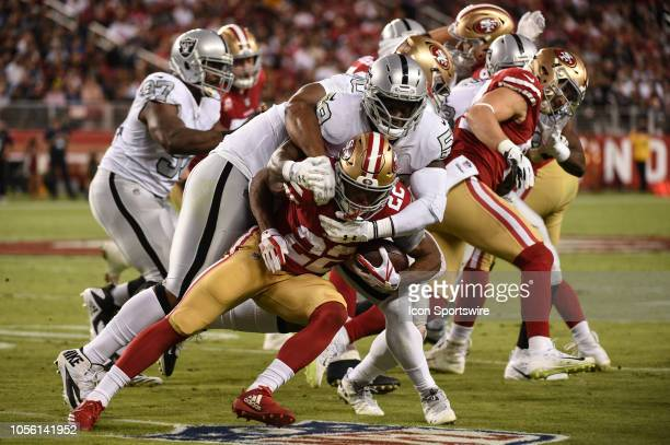 San Francisco 49ers Running Back Matt Breida is tackled by Oakland Raiders Linebacker Tahir Whitehead during the NFL football game between the...