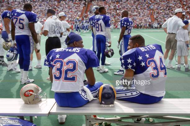 San Francisco 49ers running back Ricky Watters and St Louis Rams running back Jerome Bettis of the NFC Team talk on the bench during the 1995 NFL Pro...
