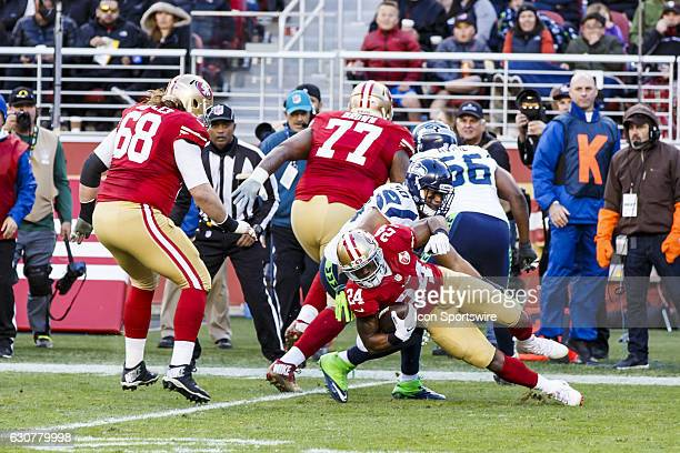 San Francisco 49ers running back Shaun Draughn tackled by Seattle Seahawks outside linebacker KJ Wright during the second half of the regular season...
