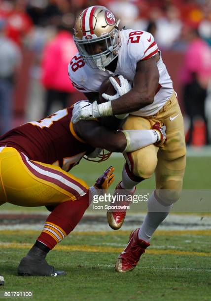 San Francisco 49ers runningback Carlos Hyde is hit and tackled by Washington Redskins linebacker Zach Brown during a football game between the San...