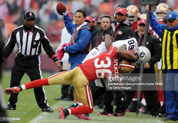 San Francisco 49ers Shawntae Spencer forces Oakland Raiders Darrius HeywardBey out of bounds after making a 4yard catch in the first quarter of their...