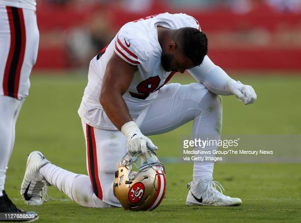 San Francisco 49ers' Solomon Thomas kneels on the field for an injured teammate during their game against the Los Angeles Rams in the fourth quarter...
