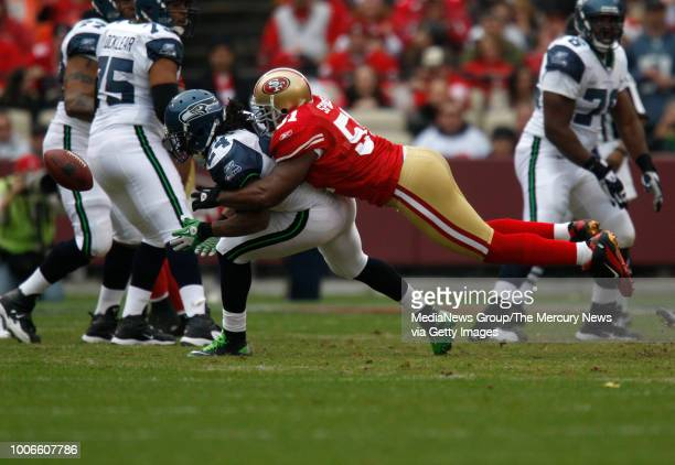 San Francisco 49ers Takeo Spikes breaks up a pass against Seattle Seahawks Marshawn Lynch in the second quarter at Candlestick Park in San Francisco...