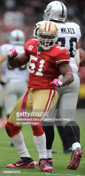 San Francisco 49ers Takeo Spikes celebrates after his interception during the fourth quarter against the Oakland Raiders on Sunday October 17 at...