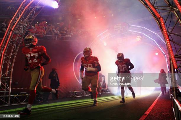 San Francisco 49ers team emerge from the players tunnel before the NFL International Series match between Denver Broncos and San Francisco 49ers at...