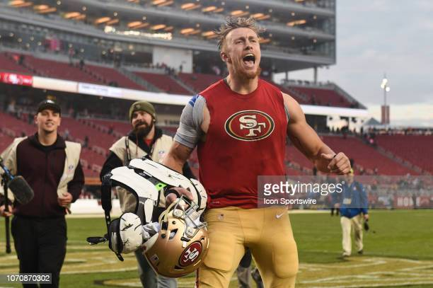 San Francisco 49ers Tight End George Kittle celebrates as he runs into the locker room after the NFL football game between the Denver Broncos and the...